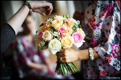 Fiona and Richard's wedding at St Patrick's Church on Soho Square and the Century Club in London Brides bouquet with pink and yellow roses