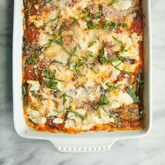 Food & Wine's cheesy eggplant rollatini is the perfect vegetarian pot-luck dish. Eggplant Dishes, Roast Eggplant, Eggplant Parmesan, Eggplant Recipes, Eggplant Zucchini, Grilled Eggplant, Vegetable Recipes, Vegetarian Recipes, Healthy Recipes