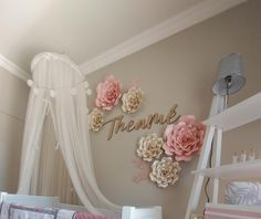 Paper roses in pink and cream decorate this beautiful nursery. #nurserydecor #vixenpaper #paperflowers #paperroses Large Paper Flowers, Paper Roses, Nursery Decor, Cream, Wall, Pink, Beautiful, Creme Caramel, Babies Rooms