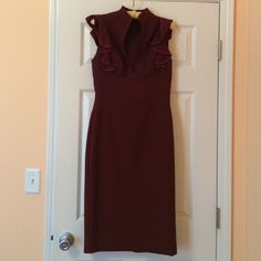 Black halo burgundy dress Super slick black halo piece, great condition, worn once. Size 2. Black Halo Dresses Midi