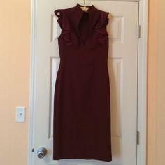 Black halo burgundy dress Super slick black halo piece, great condition, worn once. Size 2. Black Halo Dresses Midi