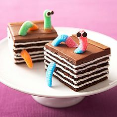 """A bookworm brownie cake, complete with sour gummy worms """"crawling"""" through the pages, is sure to surprise a child who loves to read! #birthday"""