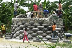 Solving Haiti's Housing Problems with Old Tires, Bottles
