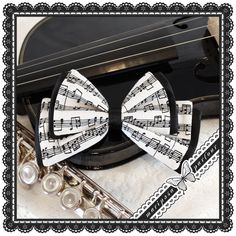 Lolita or Mori Girl Black And White Sheet Music Notes Hair Bow With Clip And Pin. $16.00, via Etsy.