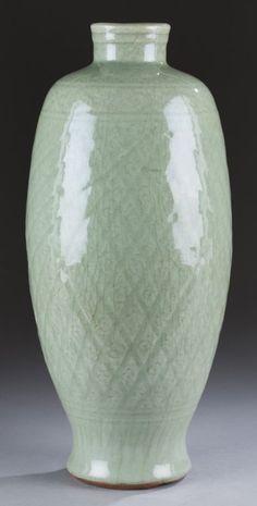 "A Chinese Longquan celadon glaze vase. Ming Dynasty. Stoneware body having ribbed pattern in celadon glaze. 15""h"