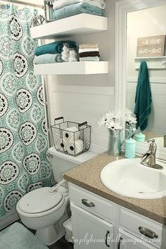 I like the basket. Simply Beautiful by Angela: Bathroom Makeover on a Budget