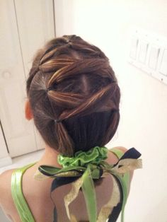 Gymnastics Hair-- Avaryana's very 1st meet. 1st section split in half then crisscrossed+ added into each side, repeat- then add into a braid bun and add your scrunchie and ribbons finish with spray glitter...super cute+easy and lasts all day!