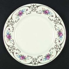 """""""Radiance"""" china pattern featuring black scroll trim with blue & purple floral details from Lenox."""