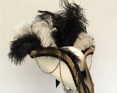 Steampunk pirate ivoryblack and gold wedding tricorn hat Pirate Wedding, Steampunk Pirate, Pirate Hats, Ostrich Feathers, Hat Pins, Victorian Gothic, Brass Chain, Black Velvet, Gold Wedding