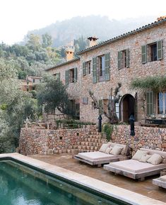 Cave House by Alexandre de Betak. Love the pool chairs!