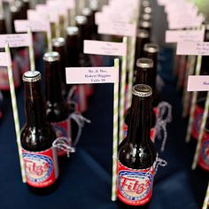 Escort cards --The groom's last name, Fitzsimmons, was the inspiration for the wedding favors, Fitz's Root beer bottles that doubled as escort cards.