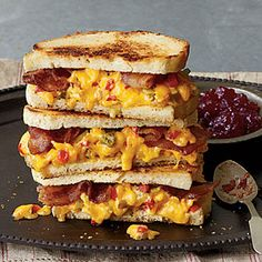 """""""Some Like It Hot"""" Grilled Pimiento Cheese Sandwiches - Made with pimiento cheese, bacon, and strawberry preserves, """"Some Like It Hot"""" Grilled Pimiento Cheese Sandwiches are the mother of all pimiento cheese sandwiches. Grill up slices of comfort for lunch or dinner today."""