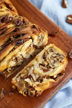Sticky babka cake folded and twisted in multiple layers of dough filled with maple syrup caramel and pecan nuts. A crossover between sticky buns and babka! Pecan Recipes, Sweet Recipes, Baking Recipes, Cake Recipes, Dessert Recipes, Maple Syrup Recipes, Pastry Recipes, Kitchen Recipes, Breakfast Recipes