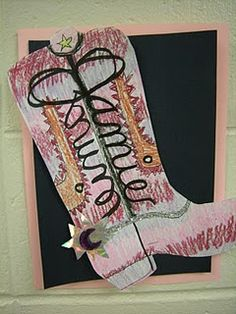 Fifth graders learned about symmetry by making cowboy boots using their mirrored names as part of the design.