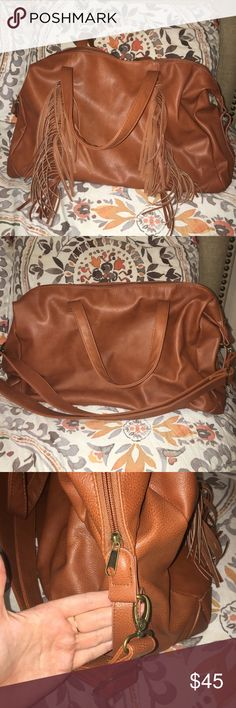 Mossimo Tassel Travel Bag (Large) Received as a present for my birthday but I never got around to using it. Brand new without tags. Never been used, never put anything in it. Has a detachable long adjustable strap. No rips, tears, stains, etc. smoke free home. No trades. Offers encouraged. Happy Poshing! Bags Satchels