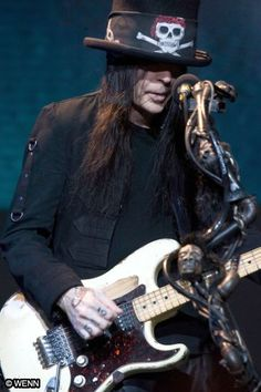 Mick Mars. He's SUCH a BadAss! Guitar player of M.Crue