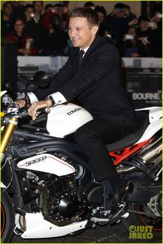 Jeremy Renner makes a grand entrance on a motorcycle at the premiere of his film The Bourne Legacy on Tuesday (August 7) in Sydney, Australia.