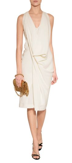 Stunning in white with a modern draped front, Donna Karan's structural jersey dress is an exquisite choice for cocktail.