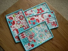 mug rugs- these colors (red and turquoise) are great for my kitchen. would love some grey and yellow for my office.