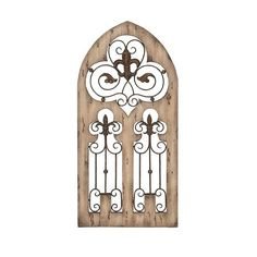 Wall decor with abbey themed design adds an enchanting look anywhere you hang it. Faux rusted iron fence work curl throughout the center of the piece. Iron rods end in charming floral ornaments.