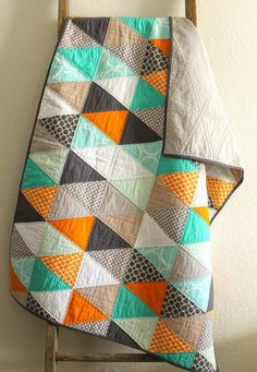 Oh, how I love a good triangle quilt.   Even more when it is gender neutral.   So bright and cozy, this one. I've been meaning to share it for quite awhile!   I hope it finds a home!   Thanks for stop