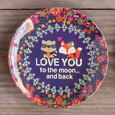 "We LOVE our Mini Melamine Plates! Perfect for gifiting small treats to friends on fun occasions, birthdays or for no reason at all! Our favorite little critters saying, ""Love You To The Moon And Back,"