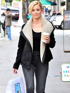 Star Tracks: Monday, November 17, 2014   WARMING UP   A cozy jacket and cup of joe keep Elizabeth Banks toasty as she goes shopping on a chilly Friday in L.A. following her Hunger Games promotional tour.