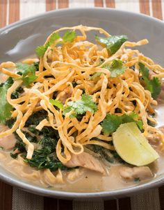An irresistible mix of noodles, coconut curry broth and Southeast Asian aromatics.