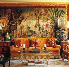 A drawing room in Paris designed by Alidad Mahloudji with 18th-century tapestry and antique velvet cushions