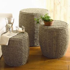 Set of three eco-friendly seagrass ottomans. Hand-twisted matching lids open to interior storage.