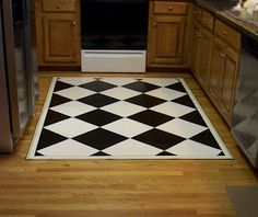 How to make a custom painted floor cloth from a sheet of vinyl flooring.