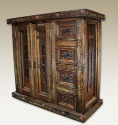 Reclaimed Wood Cabinet Western Cabinets and Buffets - Authentic and rustic, old door and reclaimed wood, no two are alike. Color, size and overall finish may vary and reflect the natural style of the piece. Storage offers main cabinet with removable shelf. Three drawers accented with wrought iron pulls.