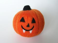 "Fang - a needle felted Jack-O-Lantern by Purple Moose Felting.  For tips, inspiration, and give-aways, ""Like"" Us on Facebook at www.facebook.com/purplemoosefelting"