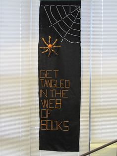 Banner in the library. Felt + yarn + sparkly spider from the dollar spot.