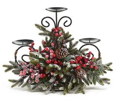 """#burtonandburton Snowy pine candleholder with red berries and pine cones on a metal form that holds 3 candles.Candleholders are 4"""" diameter.14""""H X 17""""W X 7""""D.1 set of 2.:"""