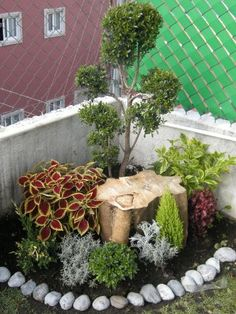 Corner small space garden landscaping.