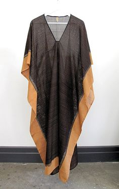 "Handwoven ikat caftan Color: caramel and black - — Length 49"" - — Width 40"" - — Handwoven cotton - — One size - — Free domestic shipping"