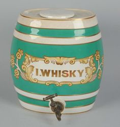 """This ceramic whiskey dispenser is in great condition. Condition (Excellent). Size 13 -1/4"""" T."""