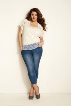 Torrid fashion white lace blouse eith blue jeans with dots