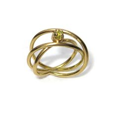 Yellow gold engagement ring in an infinity design. Made with Fairtrade gold and set with customer's own small rough green stone. Handmade Engagement Rings, Green Stone, Eternity Ring, Precious Metals, Gold Rings, Rose Gold, Yellow, Bespoke, Infinity