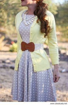 Dress, cardigan, wide belt, and pearls