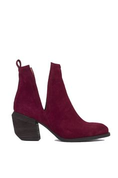 AKIRA's Jeffrey Campbell Orwell 2 Open-Side Ankle Wine Suede Booties, featuring a genuine leather upper, pull tab at back for easy slip-on, deep V side cut outs, angled & stacked wooden heel, and a pointed toe. Free standard U.S. shipping $75+.