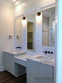 **ENVISION: Two oval mirrors; keep the lighting and plank wall; two pedestal or vessel sinks with a wood table in between for a vanity area.