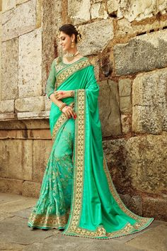 Sea green saree with blouse. Fabric - Net and art silk. Work - Thread zari embroidery, moti work in skirt, art silk with thread lace border work. Paired with the matching blouse piece.Please Note: The shades may vary slightly from the colors displ Indian Designer Sarees, Indian Sarees Online, Online Shopping Sarees, Half Saree Designs, Simple Sarees, Green Saree, Art Silk Sarees, Bollywood Saree, Beautiful Saree