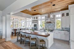 This is just awesome in everyway.  Would love to cook and entertain in this kitchen