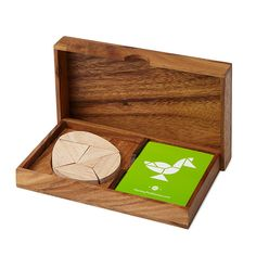 Egg Tangram Set - I personally really like this one. It's very different, ties in to eggs and turkeys. Could be displayed on a desk. You'd put the logo on the front of the box.