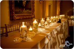 I LOVE these candles and the long head tables. Arlington Hall Wedding Decor Ideas Amber Lighting Dallas Weddings-3456