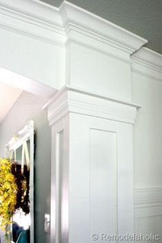 Beautiful Faux Columns with moldings remodelaholic.com #stairs #DIY #wood_stairs