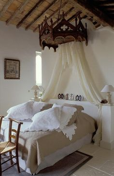 There are so many elements to love, the linens, the shelf/nightstand, canopy and rug placement.