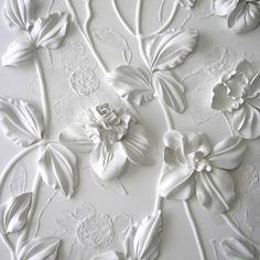 Wall art by Olefir Design. Something similar to this can be made by gluing silk flowers or paper flowers to a canvas and spray painting it white. You can also draw out designs around the flowers with glue before painting. Shades Of White, White Aesthetic, New Wall, Spray Painting, Painting Walls, Silk Flowers, White Flowers, Fake Flowers, Colorful Roses